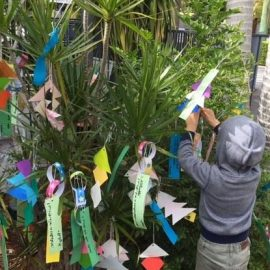 child decorating tree, japanese