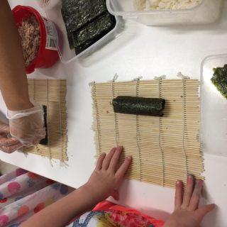 children making sushi