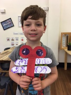 cute boy with dragonfly craft
