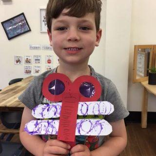 cute boy with dragonfly craft