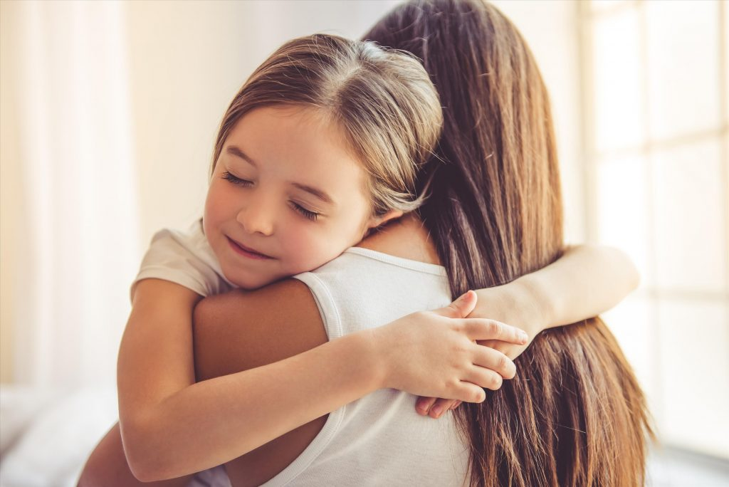 little girl hugging her mum